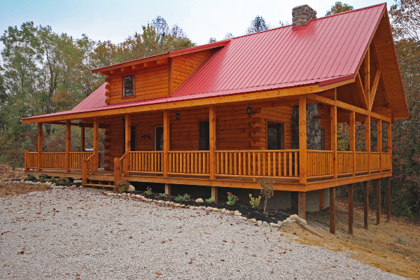 red roof cabin with wrap around porch