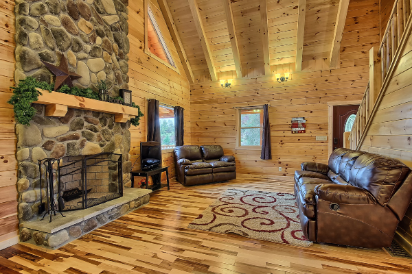 living room area of cabin, fireplace