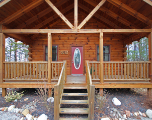 front porch of cabin in woods